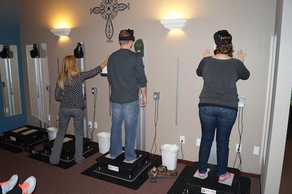 Chiropractic Glen Carbon IL Patients Using Equipment